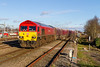 15th Jan 2016:  59202 is working 6B12 Westbury to Wootton |Basssett stone.  Because of the layout of the siding there the train has to go to Swindon and reverse.  Captured her leaving the Down Loop at Swindon