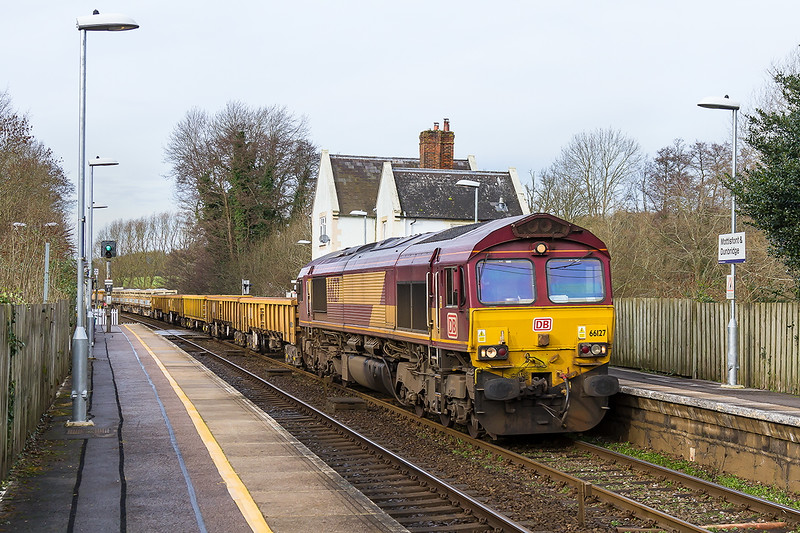13th Jan 2016:  The morning departmental from Westbury to Eastleigh, 6O41, is powered by 66127 and is captured passing through Mottisfont and Dunbridge station.