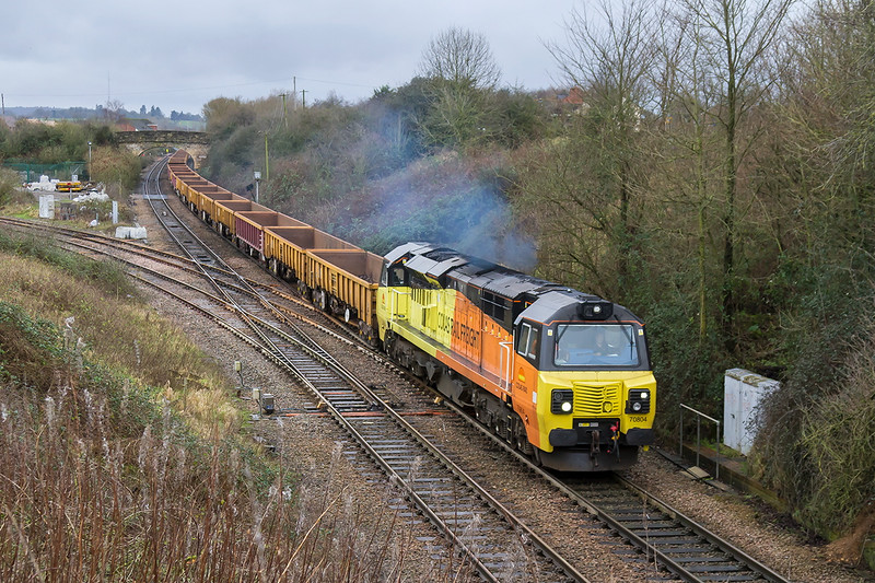 9th Dec 2016:  Passing through Hawekeridge Junction is 70804 on the point of 6C22 the 12.32 from Westbury to Castle Cary via Bristol.  At least the rain had stopped.