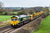 24th Jan 2016:  Running on time is 6Y19 headed by 66563 and with 66585 on the rear. Only just ove half of the HOBC is in view as it runs through Great Cheverell on the way to Fairwater Yard from Basiingstoke