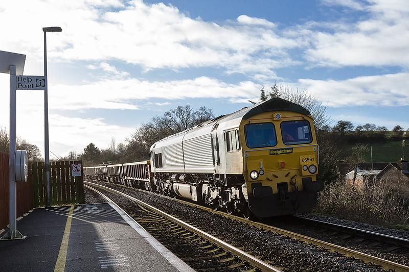 10th Jan 2016:  Dropping slowly down the grade through Dilton Marsh is 66561 with a long rake of JNAs on their way to Westbury from Basingstoke.  66531 is on the tail.  Fortunatley it was running three quarters of an houur early as if it were  on time the light would have been impsossibe