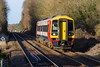 13th Jan 2016:  158880 forming 2F35 the 09.56 from Salisbury to Romsey slows for the stop at Dean.  Unfortunately this was the only perfect light of  the day