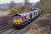 23rd Jan 2016: The Tilbury to Margam empty steel being diverted down the  Berks & Hants is seen at Lavington in the hands 0f 66080