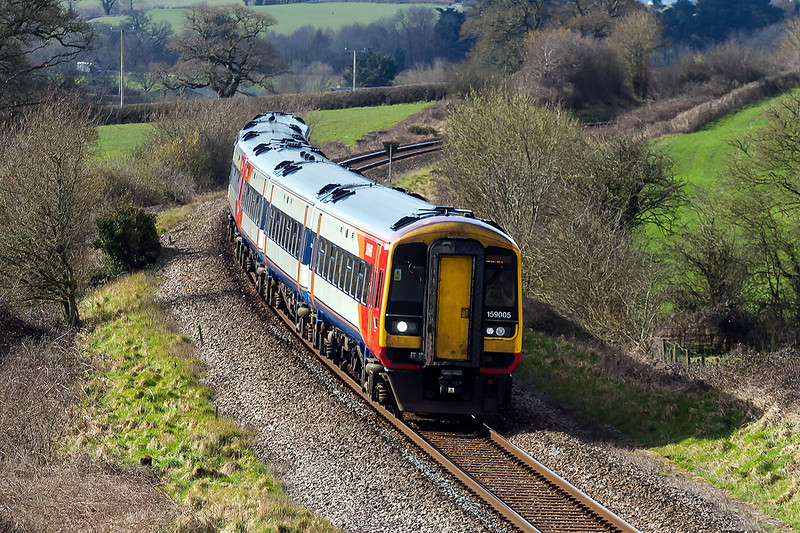 2nd Apr 2016:  159005 is about to pass under the A37 as it nears Yeovil with 1L36 the 09.23 Exeter St Davids to Waterloo