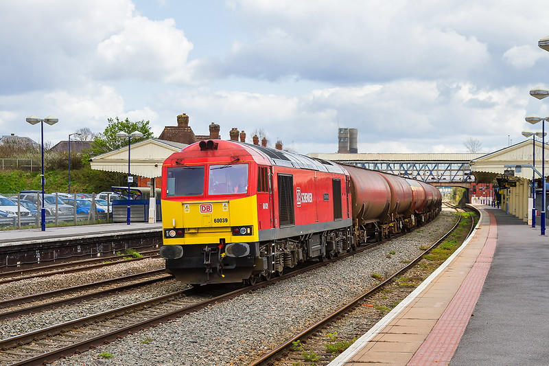 23rd Apr 2016:  Just missing the sun at Newbury is the Ex Westbury shunter 60039 at the helm of 6B33 from Theale to Robeston Sidings empty Murco tanks