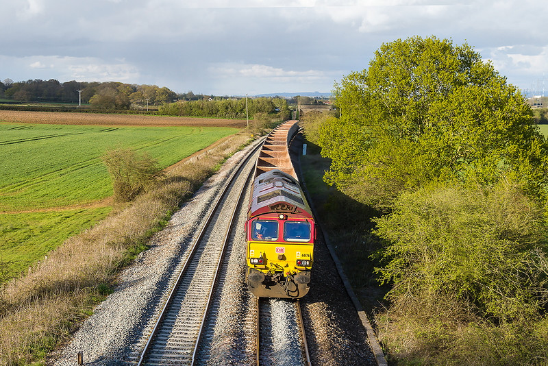 29th Apr 2016:  7V12 from Woking to Merehead is today in the hands of 66174, pictured  running through Berkley near Clink Road Junction