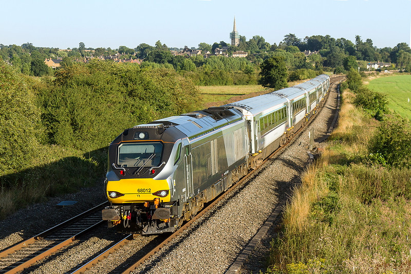 15th Aug 2016: As the evening light yellows 68012 heads north with 5U50 from Bicester North to Banbury ECS. The stock has worked to Bicester as 1N50 the 17.21 from Marylebone