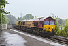 28th Aug 2016:  In very fine but heavy rain 66078 runs through Trowbridge Station on the point of 6W97 from Carmarthen to Westbury . 66074 was on the other end.