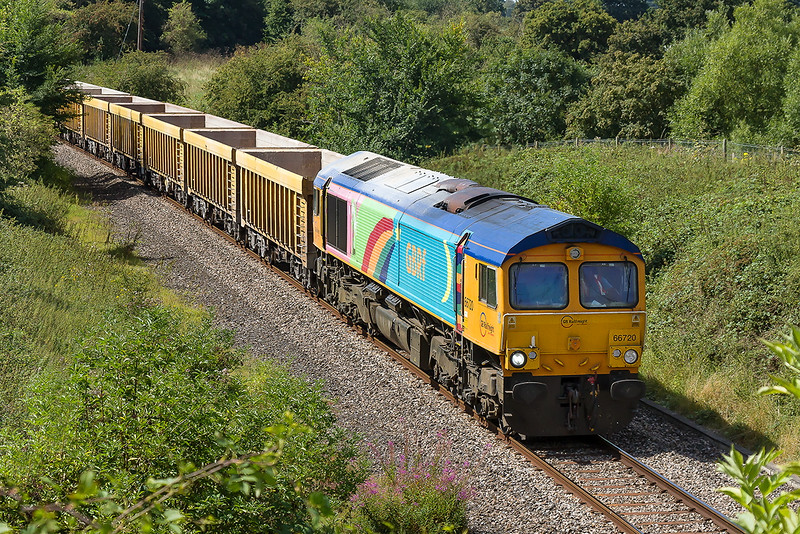 16th Aug 2016:  Passing through what has becone a very overgrown Broughton Gifford is Rainbow painted 66720 on 6M40 to Stud Farm from Westbury