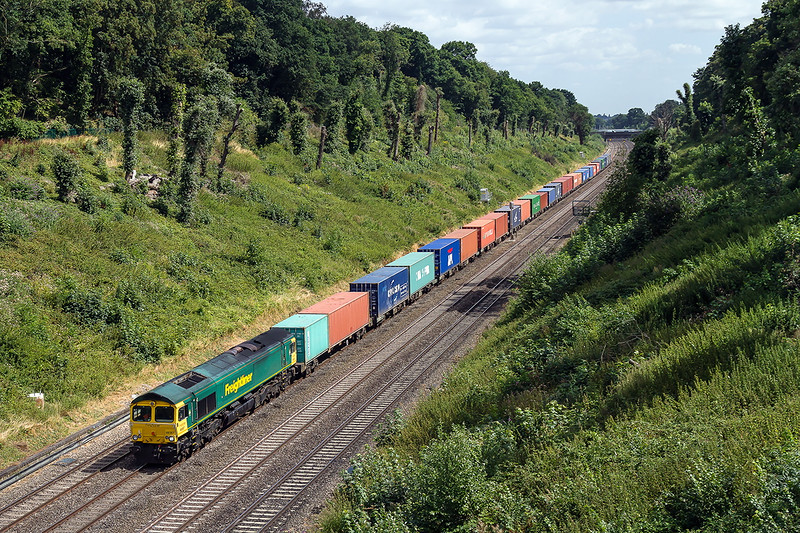 9th Aug 2016:  The 07.43 from Hams Hall Parsec to Southampton Maritime 4O15 is captured from the Warren Road bridge in the Sonning cutting in the hands of 66567