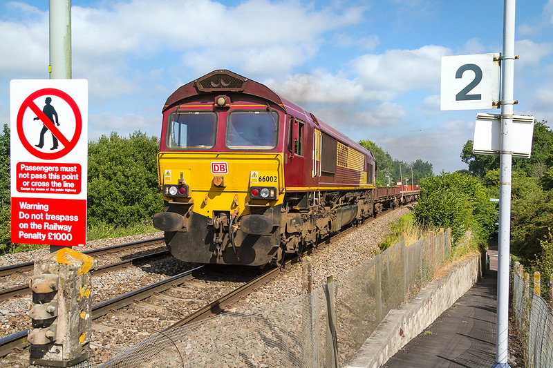 12th Aug 2016:  66002 is again tasked with working the departmental tripper to Eastleigh from Westbury.  6O41 is pictured as it runs up the hill through Dilton Marsh