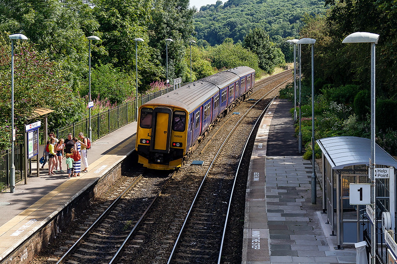 16th Aug 2016:  Summer at Freshford.   As 150938 leaves with 2C18 the 12.42 Gloucester to Frome  some passengers and their welcoming  party chat on the platform