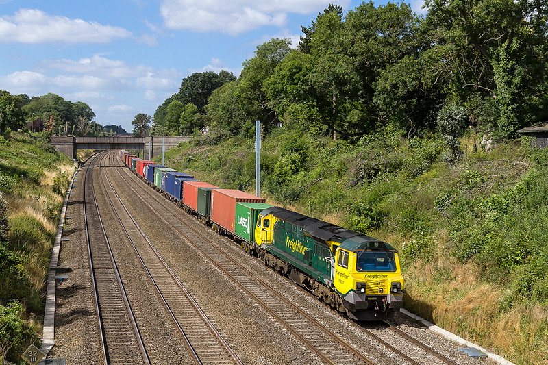 9th Aug 2016:  4M28 is the Southampton Maritime to Garston service.  Today with 70007 on the point it is pictuered in the Sonning Cuttong  from the Duffield Road Bridge.  3 days earlier the 3 posts on the right were not there.  The end is Nigh !!