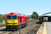 17th Aug 2016:  Having worked back to Westbury from Merehead on the front, with 59201, of 7B12 to Wootten Bassett it now has the dummy to work forward into the spur.  Sheltering from the sun in Platform 3 is 158763 which is forming 2M25 the 12.20 to Swindon