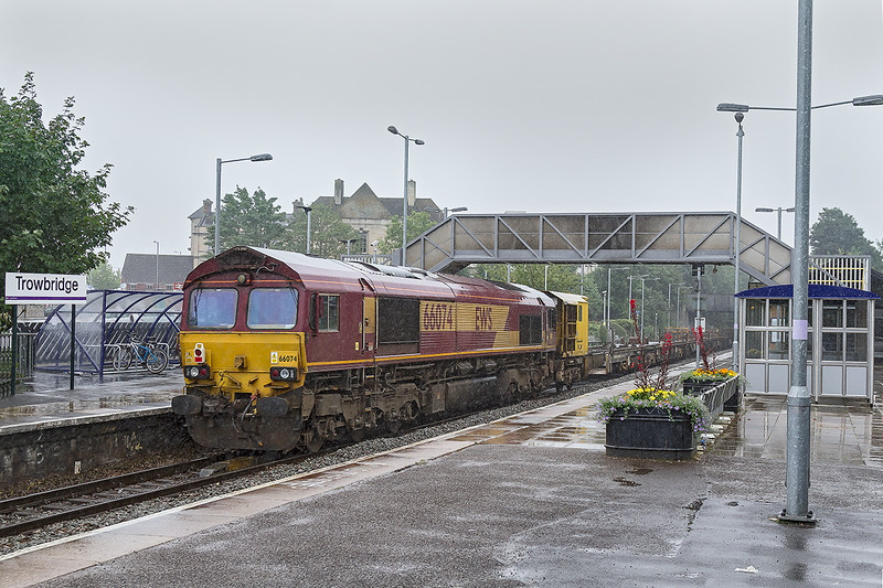 28th Aug 2016:  I fine but heavy rain 66074 runs through Trowbridge Station on the rear of 6W97 from Carmarthen to Westbury . 6676 was on the front.  The bicycle rack stand was providing the very essential  protection from the elements