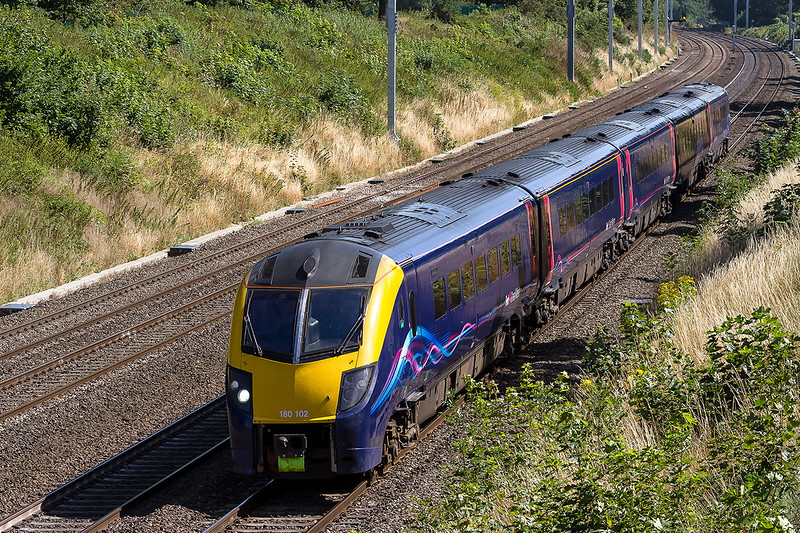 9th Aug 2016:  Adelante 180102 is non the Down Main through the Sonning Cutting as it works 1Z20 the 10.37  Paddington to Didcot Parkway