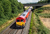 19th Aug 2016:  66101 passes under the Warminster By Pass at Heytsbury as it works 6V41 departmental from Eastleigh to Westbury
