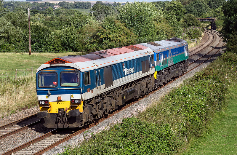 12th Aug 2016:  The 14.40 from Acton to Whatley at Great Cheverell devoid of any waggons.  59101 and 59001 were having an easy afternoon on 0C76