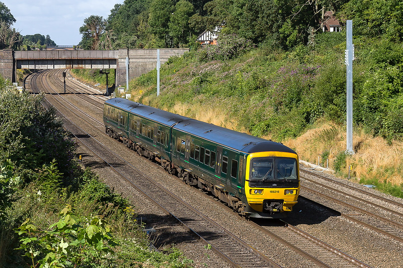 9th Aug 2016:  In the 5 hours spent in the Sonning area thisa green Turbo seemed to be the only one in use. 166216 is between Butts Hill and Duffield Road bridges as it works 1K45 the 09.39 from Bedwyn to Paddington