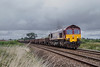 28th Aug 2016:  Leaving Trowbridge is 66002 working 6W21 from Bromsgrove to Westbury.  The dark clouds deposited their contents shortly after the train passed