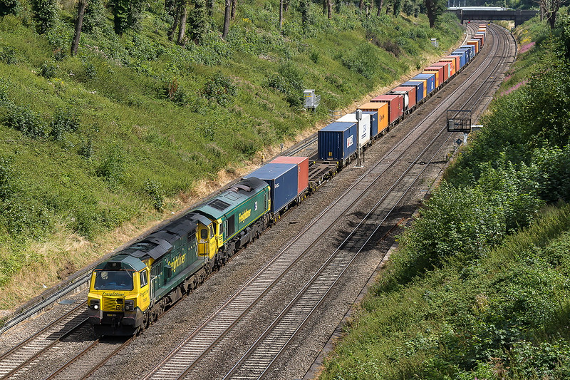 9th Aug 2016:  The 2nd double header of the day was on 4O14 the 05.36 from Garston to Southampton.  This time it is 70005 and 66593 pictured from the Warren Road bridge in the Sonning Cutting