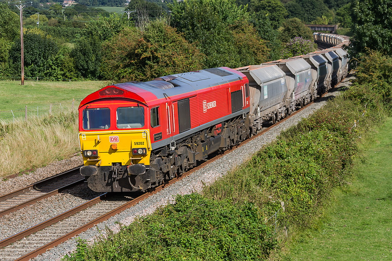 3rdh Aug 2016:  59102 in charge of 6V18 from Allington to Whatley Quarry runs through  Great  Cheverell