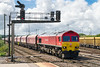 4th Aug 2016@:  The late running 6A77 11.42 from Merehead to Acton powered by 59204 has just completed a crew change at Westbury and is easing up to the home signal prior to Following an HST towards London.