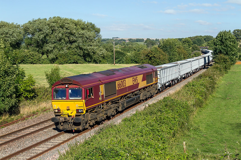 12th Aug 2014:  The day's bonus for me was  to get 6Z18 in full sun at Great Cheverell.  66003 is bringing to rakes of brand new JNA and HOA wagons, total 44, from Wembley Euro Freight Opperations Centre to Merehead Quarry