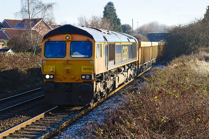 1st Dec 2016:  With frost still on the ballast 66749 nears Trowbridge with 6M40 from Westbury to Stud farm