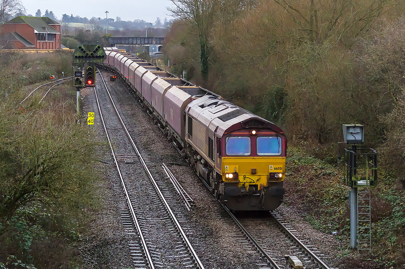 23rd Dec 2016:  66051 with Neil Higson in the chair is  taking EWS HTA coal wagons from Avonmouth National Power Silo to Worksop.  Presumably to be scrapped.  The location is Hawkeridge with Westbury station visible in the distance.  iso 3200 of course.