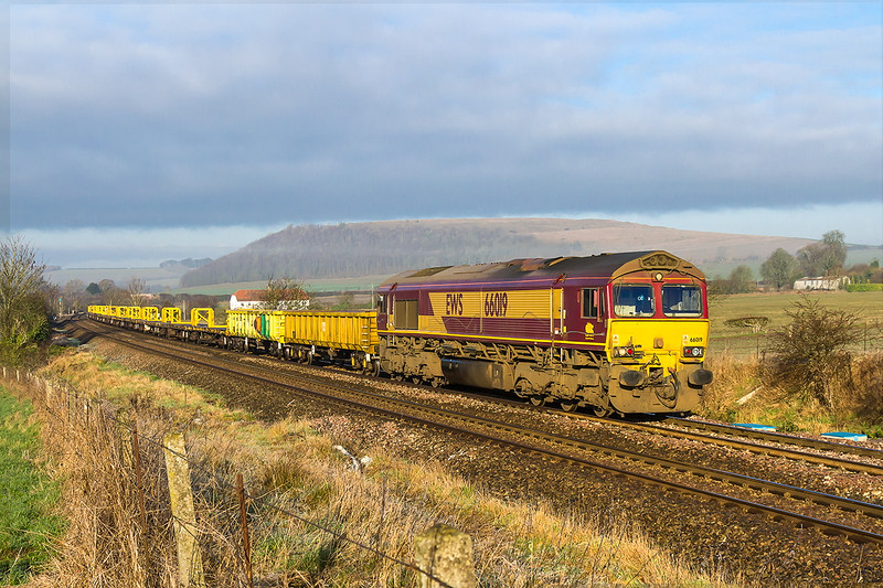 30th Dec 2016:  With the frost now melted where the sun has warmed it 66019 runs through Norton Bavant  with 4O41 the morning departmental from Westbury To Eastlweigh.  Although it is only 6 minutes since the DMU passed the white band of cloud has virtually vanished.  Shame.