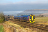 30th Dec 2016:  With a band of light mist partially masking Battlesbury Hill 158961 forming 1F07 the 08.29 from Cardiff to Portsmouth Harbour races through Norton Bavant