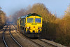 16th Dec 2016:  The pair of 66s on the Stoke Gifford FHH to Eastleigh East Yard are 66509 & 66516.  Pictured climbing through Dilton Marsh.