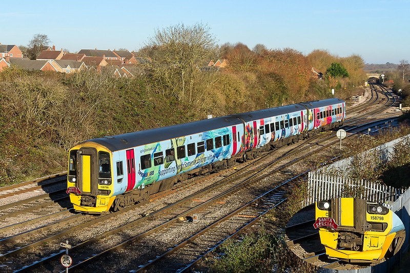 4th Dec 2016:  In perfect light 158798 arrives at Westbuyr.  2Z30 is a Santa Special from Weston Super Mare and return.  This is the first time that I have pictured one of these units carrying a headboard  'Santa Special'