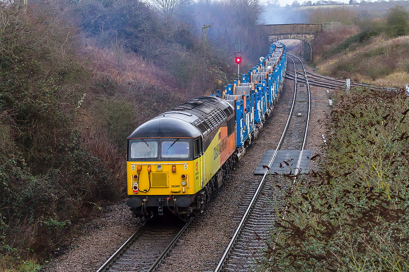 23rd Dec 2016:  56302 rides shot gun on 6T56 from Westbury to Swindon Cocklebury in awful light which required an iso setting of 3200.  This cable train has 56087 providing the urge