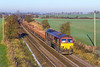1st Dec 2016:  66006 working 6O41 from Westbury to Eastleigh gathers speed after reaching the sumit of the hill at Upton Scudamore