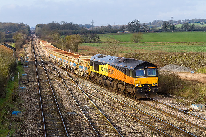 28th Feb 2016:  Taking the station line at Fairwood Junction with 2 sets of Side Tippers and a couple of Odds and Sods is 66848 in charge of 6C22 from Exeter St Thomas to Westbury.  Due to family commitmwnts this will almost certainly my only rail shot of the day.