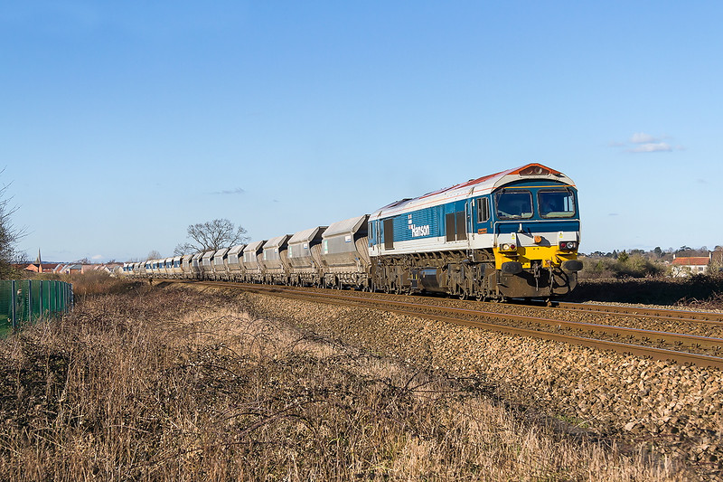 24th Feb 2016:  59102 'Village of Chantry'  passes the White Horse Business Park at North Bradley  with 6A83 from Bennets Siding in Avonmouth to Wesr Drayton