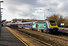 2nd Feb 2016:  43148 in 'Building a Greater West' vynils stands at Swindon as it works 1L60 the 12.55 from Cardiff to Paddington