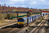 23rd Feb 2016:  At Undy 66302 is captured at it works 4V38 from Daventry to Wentloog with the Tesco Express. The bridge  over nothing orriginally  went over the approach lines to the Severn Tunnel Junction siding complexes