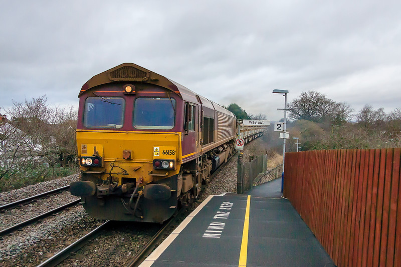 1st Feb 2016:  Not the shot that I had planned of 66158 climbing through Dilton Marsh with the morning Departmental, 6O41, to Eastleigh from Westbury.  I had only just got to the platform when it came  so it was a case grab the camera point and shoot.  Using my old Canon 50D and a Canon EFS 17-85, the settings turned out to be.  Manual Exposure 1/2500 at f5 with an ISO setting of 3200.  Perhaps I should stick with these settings !