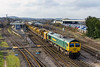14th Feb 2016:  66585 Rides shotguns on the HOBC as it works from Basngstoke to Taunton Fairwaterr Yard.  Due to the line closure between Bristol and Taunton the service was diverte to run via Melksham,  66536 was doing all the work