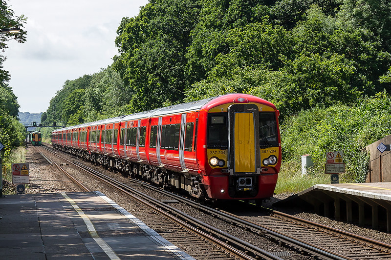 4th Jul 2016:  The 11.48 Gatwick Express service from Brighton to Victoria climbs through Burgess Hill. Formed of a 12 car set 1A40 lead by 387204