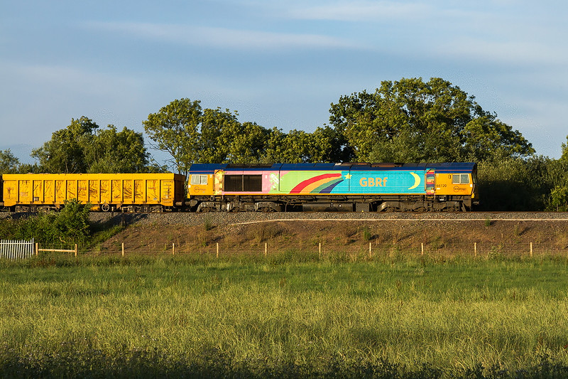 31st Jul 2016:  At 7.51 pm 66720 is captured in beautiful evening light at Yarnbrook, between Triowbiridge and Westbury, with a loaded rake of IOA wagons.  6O27 started from Bescot Down Side at 16.00 and is heading to the Eastleigh East Yard.  One day I shall manage a picture of the other side of this locomotive.......Perhaps !