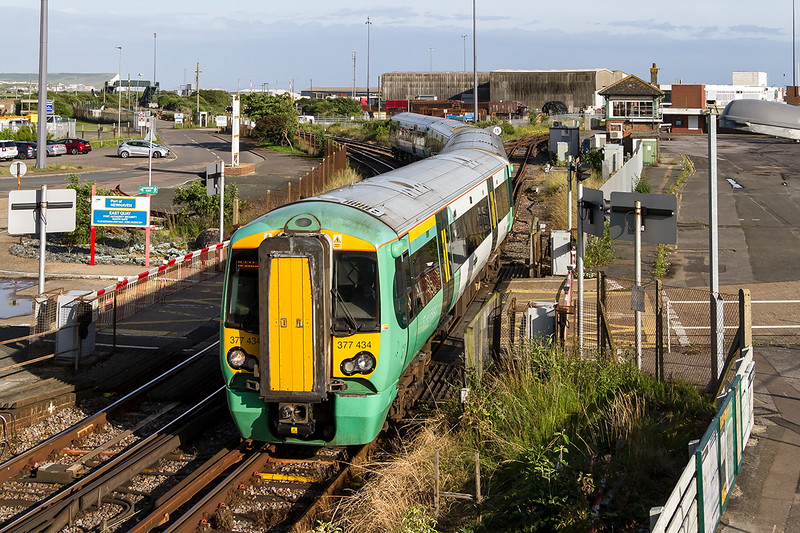 1st July 2016:  Running 11 minutes late is 377434 forming 2F84 the 18.24 from Seaford to Brighton as it arrives at Newhaven Harbour.  The lateness was caused by it arriving late at Seaford
