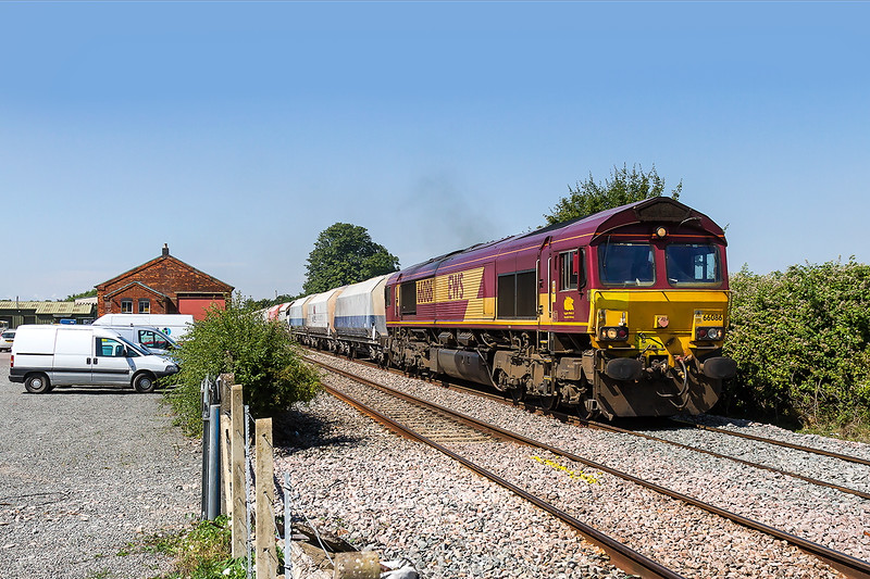 20th Jul 2016:  Passing the old goods shed at at site of Edington & Bratton station is 66086 with 6M26 from Whatley Quarry to Hayes & Harlington