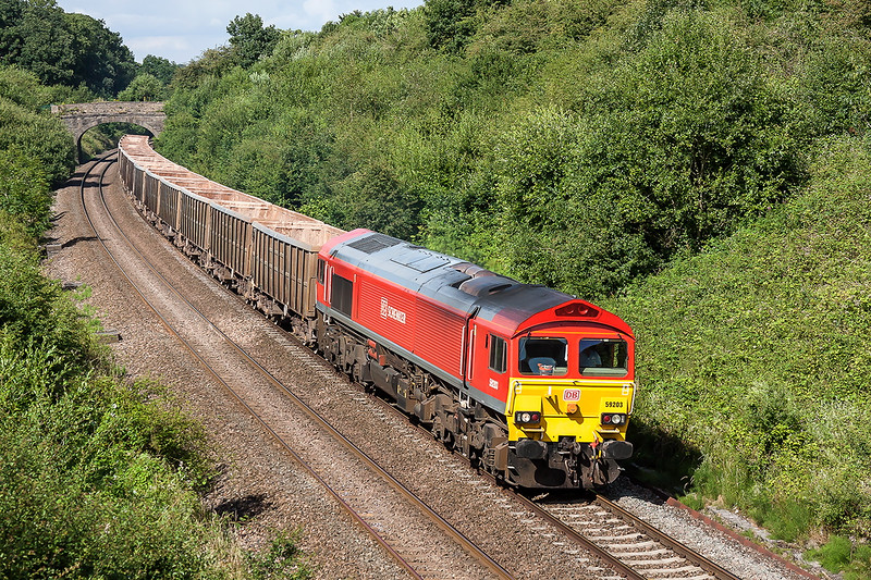 14th Jul 2014:  Rounding the curve at Clink Road Junction is 59203 bringing the empties from Chichester back to Merehead Quarry