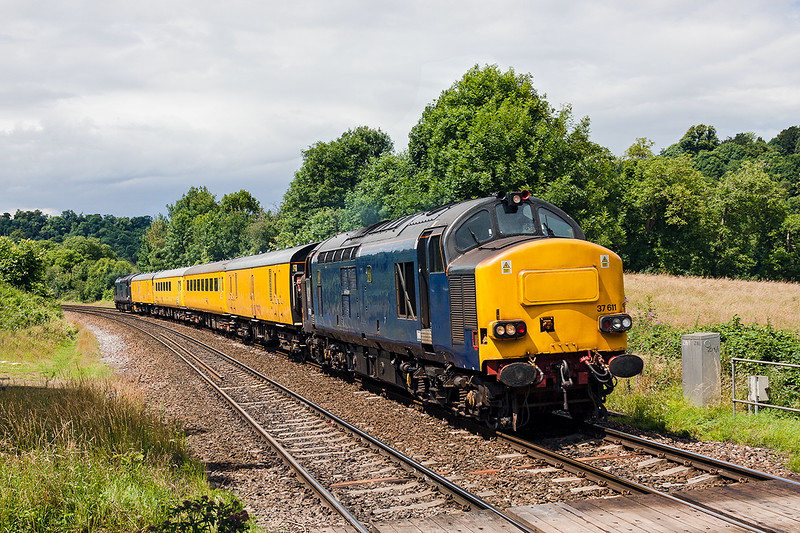 13th Jul 2016:  Part of the itinary for 1Z79 which started from Tyseley LMD and ended at Bristol Temple Meads  was to go the Heywood Road Junction at Westbury.  Headed  by Rail Operating Group loco 37611 and with 37608 on the tail the test train, actually operated by Colas, is captured at Freshford in a very fortunate patch of sun.