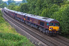12th Jul 2016:  Royal Scotsman liveried GBRf 66746 & 66743 are pictured at Sherringtonn  in the Wylye Valley as they work 1Z81.  The day's itenery started at Gloucester and went to Newton Abbot where it reversed  on it's way to Bath.  After a break it now going to Oxford via Southampton.  A close inspection will show that it was raining at just the wrong moment.