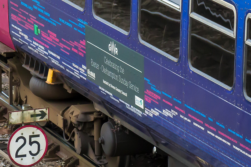 15th Jul 2016:  A monster crop to show the vinyl celebrating the new Sunday service on the line to Okehampton on the side of 153377